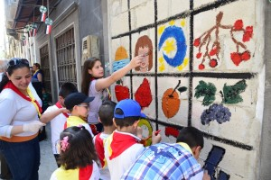 Painting in the streets of Homs: ACN photo