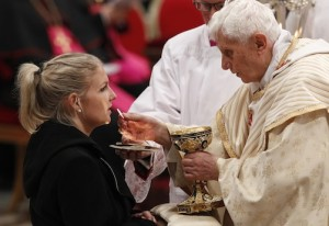 POPE DISTRIBUTES COMMUNION AS HE CELEBRATES CHRISTMAS EVE MASS IN ST. PETER'S BASILICA AT VATICAN