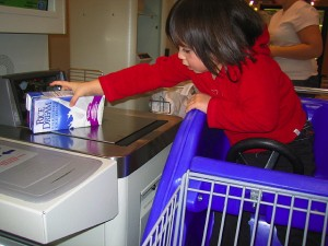 Child Operating Self Checkout