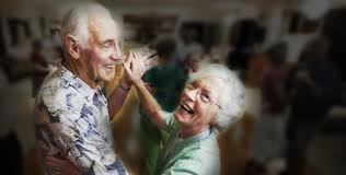 Elderly couple dancing romancing