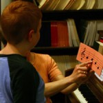 boy learn music lesson piano notes