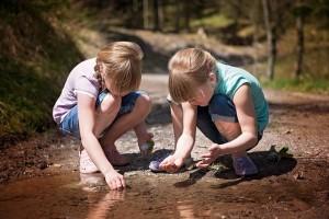 girls waters edge pond lake
