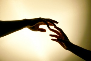 hands touching reaching out