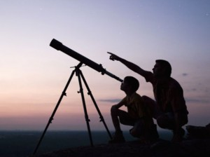 looking through telescope