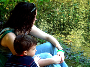 mother son mom child river outside quiet pensive