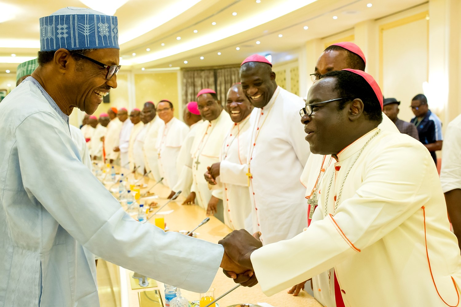 President Buhari greets Bishop Matthew Kukah; photo courtesy of the Catholic Bishops' Conference of Nigeria