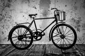 old-bicycle-on-a-wooden-floor-1393857695p5g
