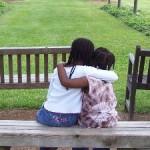 sisters hugs hugging park outside friends little girls