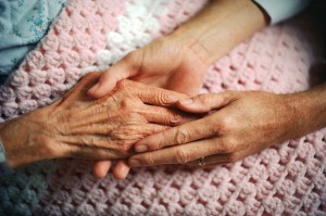 Holding Hands with Elderly Patient aging old