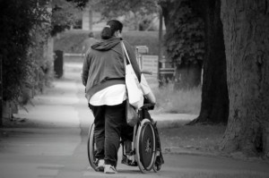 woman pushing wheelchair
